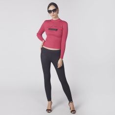 Textured Crew Neck Crop Top with Long Sleeves and Zip Applique