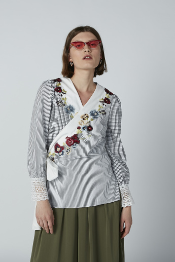 Iconic Embroidered V-neck Top with Lace Detail and Long Sleeves