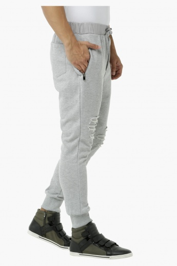 Knitted Jog Pants with Zip Pockets and Distressed Finish