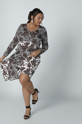 Printed Asymmetric Dress with Round Neck and Long Sleeves