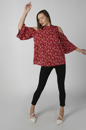 Koton Printed Cold Shoulder Top with High Neck and Flared Sleeves