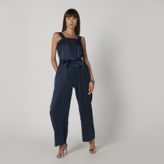Textured Sleeveless Jumpsuit with Pocket Detail and Tie Ups